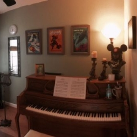 Upright Samick piano in my home studio.  Studio is freshly painted and decorated with vintage Disney!