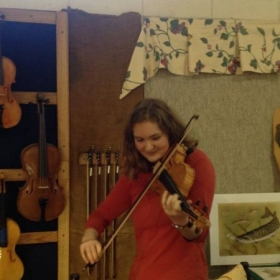 Playing a brand new violin at the State Fair.