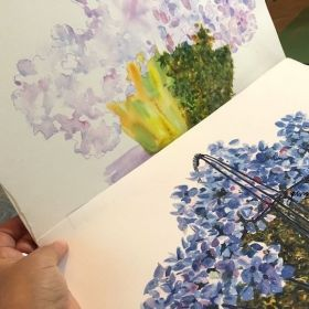 A step-by-step painting to create a basket of blue hydrangeas in watercolor.