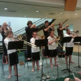 "A trombone quartet performing Kevin Austin's piece ""Mellified Man"" while being mellified. I'm on the far right."