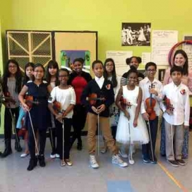 With 6th grade violin class after their 2nd recital