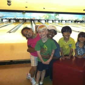 Having fun with my piano students at a Bowling Party I gave them for hard work!