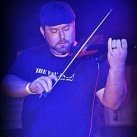 Performing live with my electric violin, an NS Design WAV 4-string.