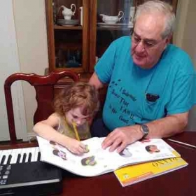 Eliana, age 5, taking her first keyboard lesson