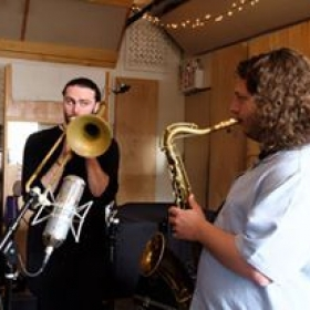 Billy in the studio recording horn parts for Sideway Paving Co's recent album