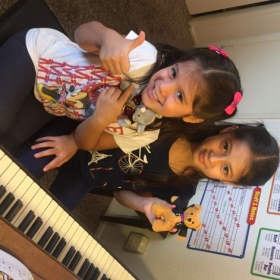 Young students with Music for Little Mozarts plush animal manipulatives.