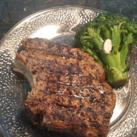 "Butter Grilled Pork ""Rib-eye"" Steak with steamed broccoli."