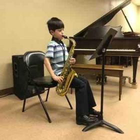 One of my students performing at his recital