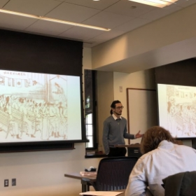 me presenting at MAPSS academic conference at the University of Chicago in May 2018.
