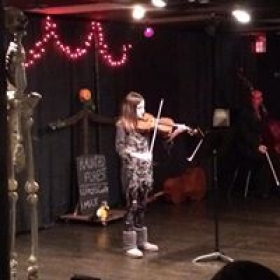 Student performing at Halloween Concert