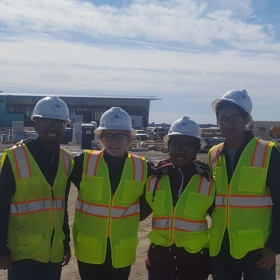 Taking high school students to a construction site to learn about physic concepts in regards to building design and construction.