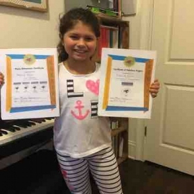 Piano Student Rebecca Voicu after she finished Faber Level 1 ☺️