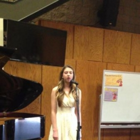 Vocal student singing Adele at recital