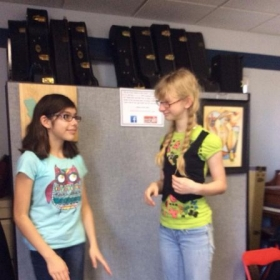 "A couple of homeschool ladies working on the ""Cup Song"" for their talent show!"