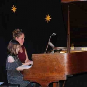 Accompanying my middle child in last December's recital.