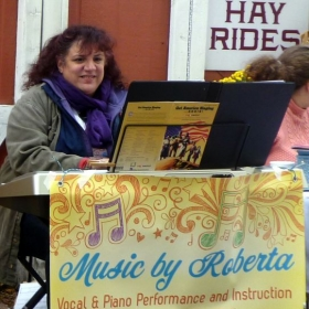 Teacher hard at work.  Music by Roberta performed outdoors at a  local fall festival