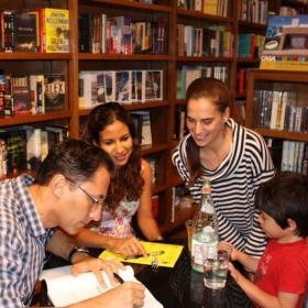 Signing our first book at Books and Books