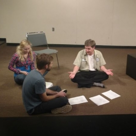 """Director Andrew Burnette breaking down a scene with student actors in """"Bolsheviks, Ho!"""" as part of the Theatere's educational focus."""