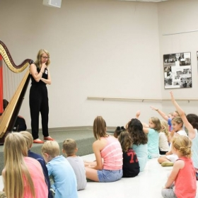 Giving a harp demo to a group of enthusiastic kids at a library in Hattiesburg, Mississippi