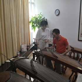 Learning to play the Gu Zheng in Shanghai.
