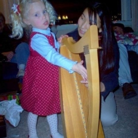 Teaching my young student how to strum the harp