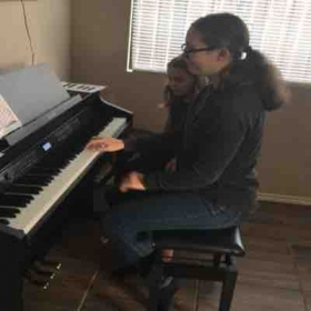 Two sisters help each other in music journey.