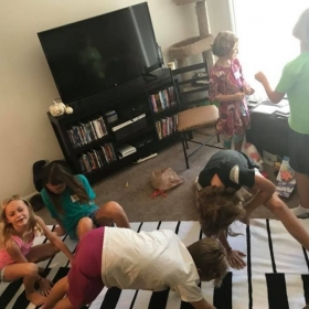 Student enjoying a game of piano Twister at Piano Club!