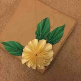 Gift wrapping with paper flower and leaves