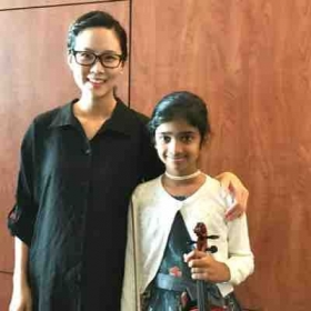 Picture with student after student recital playing