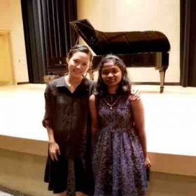 Picture with student after student recital playing at Harris Center