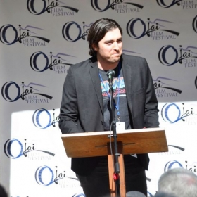 Zach accepts an award at the 2018 Ojai Film Festival.