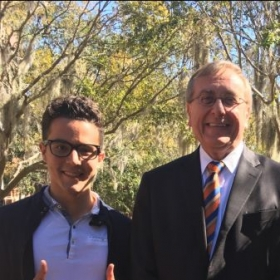 Me (left, obviously) and President Fuchs (right, duh) smiling glamorously.