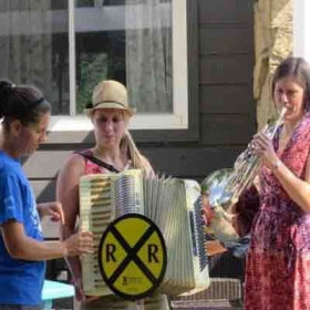 """Playing French Horn with friends in an impromptu performance of the """"Thomas the Tank Engine"""" theme song for my son's birthday party."""
