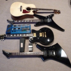 My Ibanez Acoustic/Electric, Jackson Warrior, Gibson Les Paul, and Jackson Kelly.