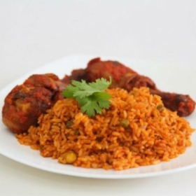 One of West Africa's best cuisine dish. Jollof Rice Red beans, with mixed vegetables and any choice of meats.
