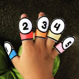 A young 4 year old boy was learning his finger numbers!
