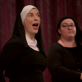 "Me on the left as Reverend Mother from the musical, ""Nunsense."" Here we are singing the song, ""Holier Than Thou."""