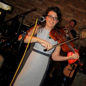 Rocking out (singing and playing violin) in my band in 2015