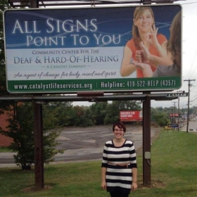 This is me in front of my department's billboard.