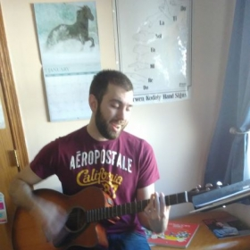 One of our vocal students using his guitar skills to create music. So proud of him.