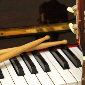 I teach multiple instruments. Guitar, piano and drums. Play by ear without reading music.