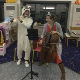 "Playing ""Baby Shark"" for children's hospital patients with Sharing Notes in a hedgehog onesie!"