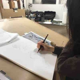 Working with a drawing student