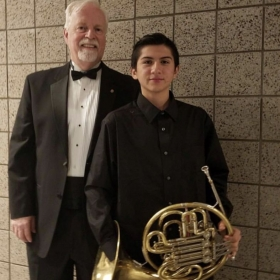 Me with the conductor of the honor band in which I was accepted into.