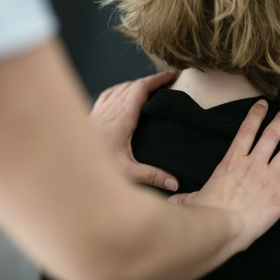 An example of an Alexander Technique lesson, using the hands to sense and give postural suggestions to the student. Photo: In Her Image
