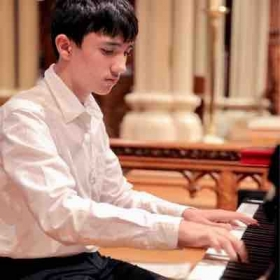 A piano student at solo recital. Approximate age, 11.