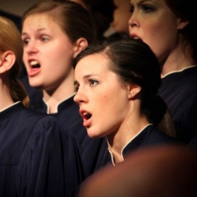 "Singing in the elite ""Mississippi College Singers"" choir."