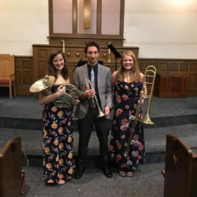 A picture of the brass trio I played with during my time at CCM just after we had finished performing a chamber recital for the community.