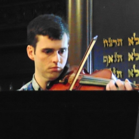 An adult student performing on the spring recital.