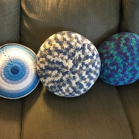 A trio of round pillows I made from Bernat Blanket Yarn.